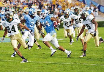 North Carolina senior tailback Johnny White zig zags his way en route to his 67-yard touchdown in the fourth quarter of Saturday's game against William & Mary. White tallied a career-high 164 yards on 29 carries. It was this go-ahead touchdown that put UNC back on top after being down by 10 points entering the final 15 minutes.