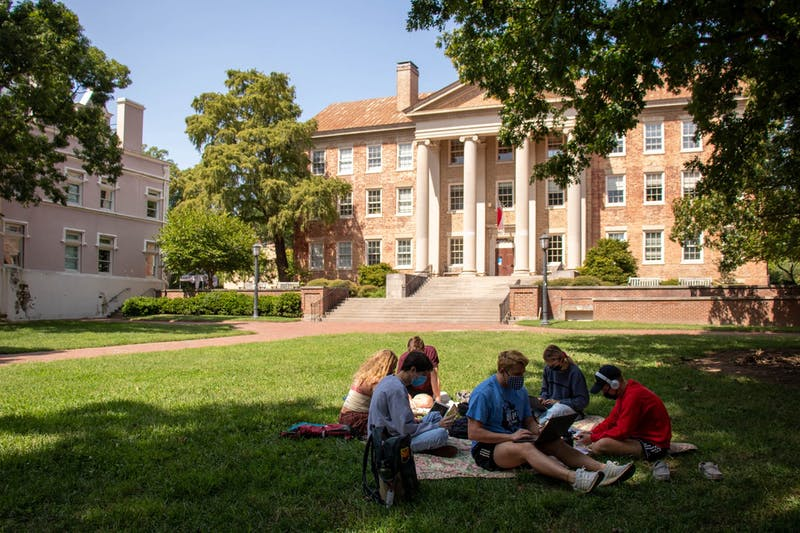 A group of students wearing masks study together at the quad, Polk Place, on Tuesday, Sept. 15, 2020