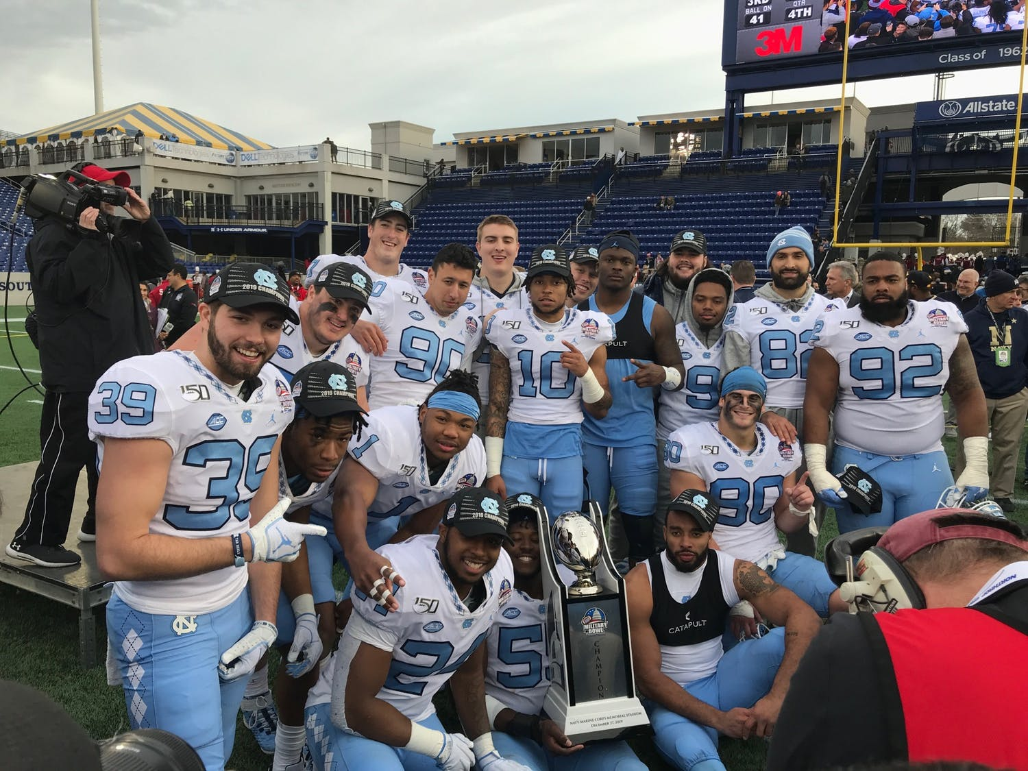 The seniors on the North Carolina football team celebrate after winning the Military Bowl on Friday, Dec. 27, 2019 against Temple 55-13.