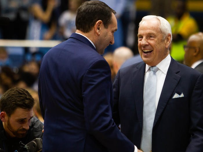 Duke's head coach Mike Krzyzewski (left) and North Carolina's head coach Roy Williams (right) greet each other at halftime during the game against Duke in the Smith Center on Wednesday, Feb. 8, 2020.  UNC lost to Duke 98-96.