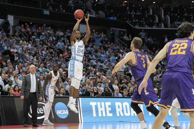 Kenny Williams (24) shoots a three against Lipscomb in the first round of the NCAA Tournament in Charlotte on March 16.