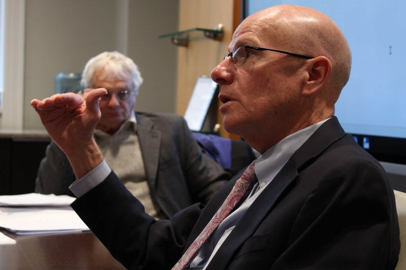 Executive Vice Chancellor and Provost Robert A. Blouin (front) and Chairperson of the Faculty Lloyd Kramer discuss lagging faculty salaries during the Faculty Executive Committee's meeting on Monday Jan. 27, 2020.