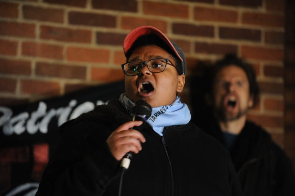 <p>Maya Little speaks before a shouting crowd during a protest against Chancellor Carol Folt and the Board of Trustees' proposal for Silent Sam's relocation in the Peace and Justice Plaza on Monday, Dec. 3, 2018.&nbsp;</p>