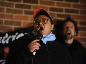 Maya Little speaks before a shouting crowd during a protest against Chancellor Carol Folt and the Board of Trustees' proposal for Silent Sam's relocation in the Peace and Justice Plaza on Monday, Dec. 3, 2018.