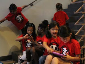 Students from Glenwood Elementary School's Friends of Chinese Dual Language program play outside of the heavily attended Chapel Hill- Carrboro City Schools meeting on May 17, 2012 about dual language.