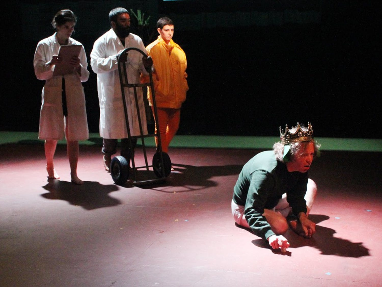 Cameron Ayres (right), playing the character of Lamb, rehearses a scene in which he is approached to receive treatment.