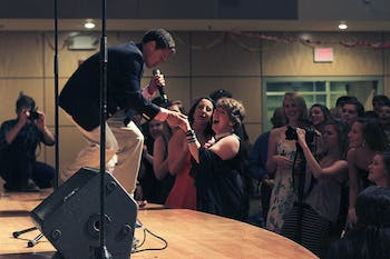Michael Batres of the UNC Achordants sings to Lana Morgan at the Joy Prom in the Great Hall of the Union on Thursday.