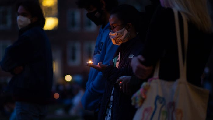 Students share a moment of silence at the Campus Y on Sunday, March 21, 2021during a vigil in honor of the lives lost during a shooting in Atlanta.