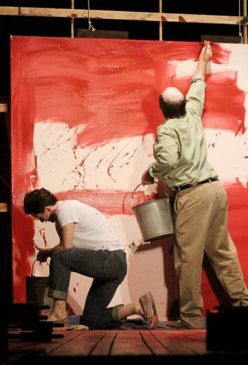 """RED-- STEPHEN CAFFREY (bald/old) as Rothko and MATT GARNER (young) as Ken in they PlayMakers Repertory Company's production of """"Red""""  by John Logan."""