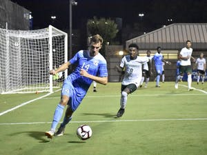 Senior forward Nils Bruening (14) dribbles the ball outside the penalty box in UNC's 2-0 win over Jacksonville on Sept. 3 at Koskinen Stadium.