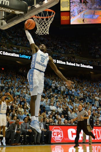 Guard Jalek Felton (5) slams home a fast-break dunk against Boston College on Dec. 9 in the Smith Center.