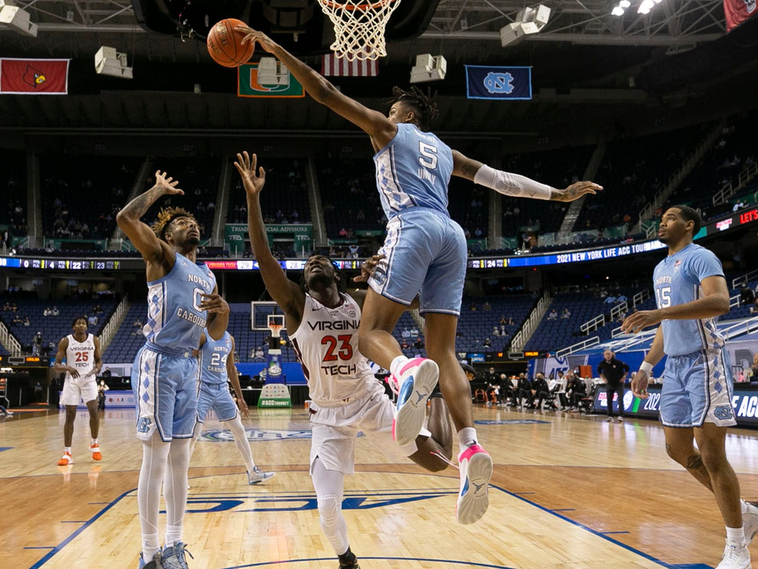 UNC sophomore forward/center Armando Bacot takes the ball in the ACC Tournament Quarterfinals against Virginia Tech on Thursday, March 11, 2021 in the Greensboro Coliseum. The Tar Heels beat the Hokies 81-73. Photo courtesy of Robert Willett/The News & Observer.
