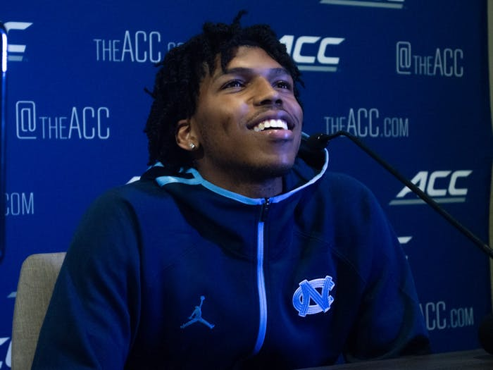 UNC sophomore guard Caleb Love smiles at the 2021 ACC Men's Basketball Tipoff in Charlotte, NC on Oct. 12.