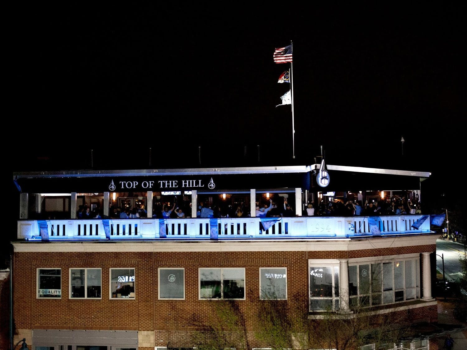 Top of the Hill lit up after the 2017 Men's Basketball NCAA Tournament Championship. From https://www.thetopofthehill.com/toporestaurant