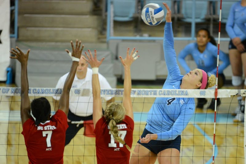 UNC outside hitter Leigh Andrew (4) hits the ball.