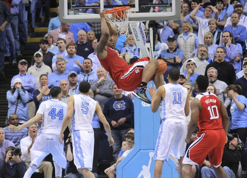 BeeJay Anya (21) dunks over the UNC defense for two of his five points.
