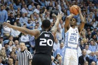 North Carolina guard Kenny Williams (24) shoots a 3-pointer during the first half on Feb. 27 at the Smith Center.