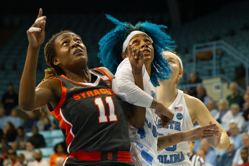 UNC redshirt senior Madinah Muhammad (3) tries to get a rebound against Syracuse guard Gabrielle Cooper (11) defends during a game in Carmichael Arena on Thursday, Feb. 13, 2020. The Orange beat the Tar Heels 74-56.