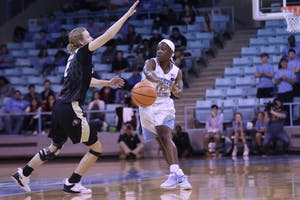 Guard Jamie Cherry (10) passes the ball during a game against Colorado on Sunday afternoon in Carmichael Arena.