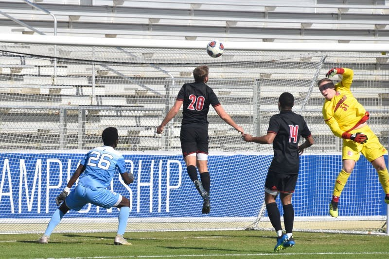 Louisville scrambles to defend a cross passed to UNC junior Jelani Pieters (26) during the ACC tournament game on Sunday, Nov. 11, 2018 at WakeMed Soccer Park. UNC lost to Louisville 0-1.