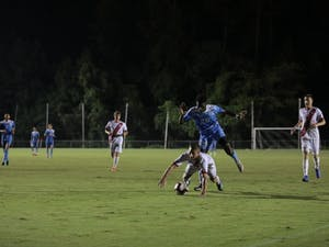 Forward (26) Jelani Pieters hops over an opposing player in a battle for the ball during Sunday's Men's soccer match vs Indiana University on Aug. 26 at WakeMed Soccer Park in Cary, NC.
