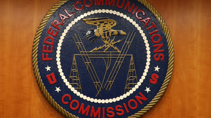 The seal of the Federal Communications Commission hangs inside the hearing room at the FCC headquarters February 26, 2015 in Washington, D.C. Photo courtesy of Mark Wilson/Getty Images/TNS