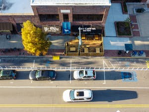 Cars drive down Franklin Street on Monday, Oct. 26, 2020 outside of Four Corners, which has built outdoor seating to accommodate for the pandemic but poses some accessibility problems.