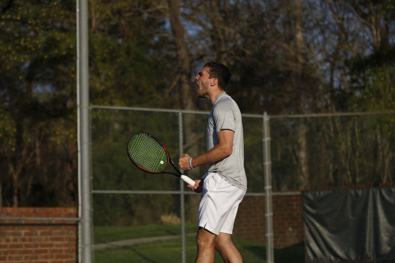 UNC men's tennis junior William Blumberg celebrates after winning a match during a singles set against NC State on Wednesday April 3, 2019. UNC beat NC State 4-0.