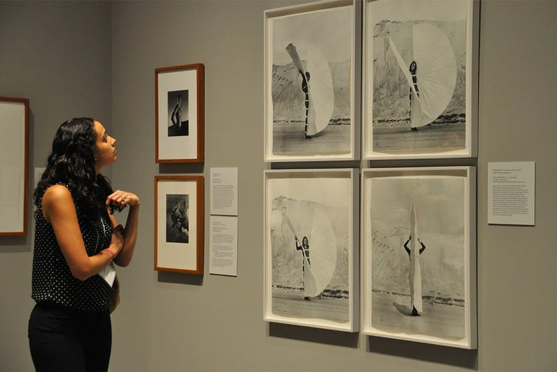 "Ackland Art Museum opened its exhibit ""PhotoVision"" on Thursday, Sept. 18, 2014. The exhibit featured around 150 photographs tracing the history of photography from the nineteenth century to the twenty-first century. Above is Sarada Schossow, a guest at the opening."
