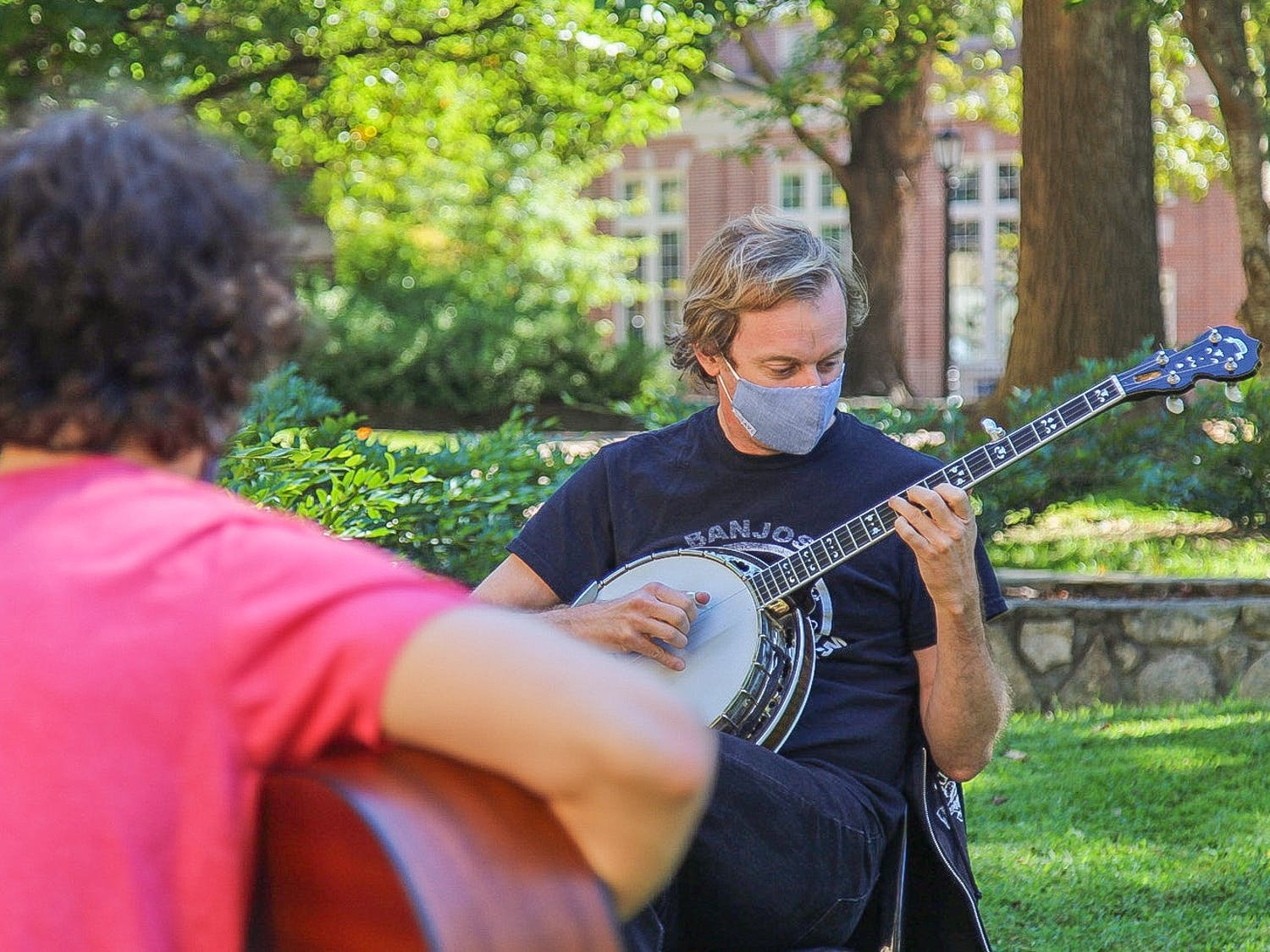 Students play their instruments while socially-distanced and wearing masks on Monday, Oct. 5, 2020.