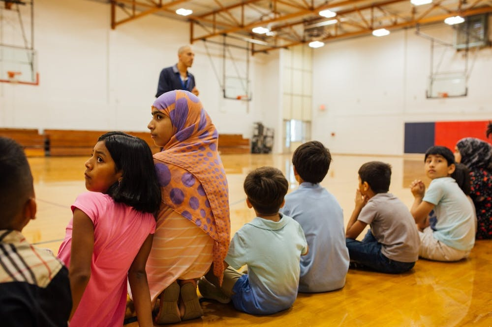 Refugee students gather at Jordan High School for World Relief's annual Refugee & Immigrant Summer Enrichment (RISE) camp in the summer of 2019. Photo courtesy of Adam Clark.