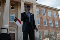 Rev. Dr. T. Anthony Spearman, 67, of Greensboro, addresses the crowd at an NAACP gathering in front of South Building on Friday, March 22, 2019. The NAACP called the demonstration to condemn the actions of UNC and UNC Police in response to an incident last week when a Confederate group brought guns to campus and were not arrested.