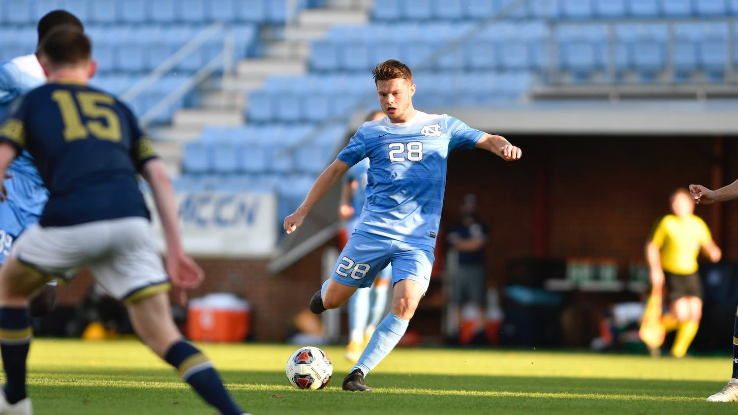 UNC's first year midfielder Tim Schels (28) kicks the ball during the first round of the ACC tournament against Notre Dame in Dorrance Field on Sunday, Nov. 15, 2020. UNC fell to Notre Dame 1-0. Photo courtesy of Dana Gentry for UNC Athletic Communications.