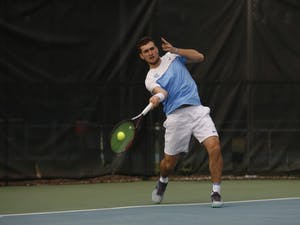 Junior William Blumberg, undecided major, prepares to hit the tennis ball as he plays for the UNC men's tennis team against Duke on Thursday, Feb. 28, 2019 at the Cone-Kenfield Center. UNC won 4-1. Blumberg won his doubles match 6-4 and lost his singles match.