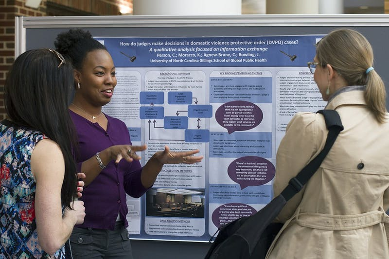 Cara J. Person, a doctoral student in the Gillings School of Public Health, explains her research on judge assistance in domestic violence cases during the Gender Violence Conference in Rosenau Hall Wednesday afternoon.
