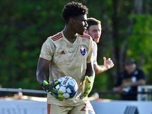 Nicholas Holliday holds a soccer ball at a game. Photo courtesy of  Megan O'Keefe/North Carolina FC.
