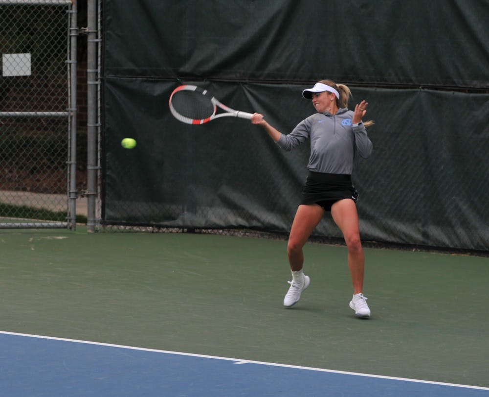 <p>UNC senior Makenna Jones returns the ball against her opponent on Friday, Feb. 28, 2020 at the Cone-Kenfield Tennis Center. Jones won her set against Virginia. UNC defeated Virginia 6-1.</p>