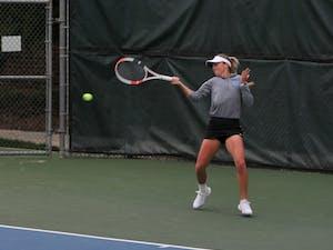UNC senior Makenna Jones returns the ball against her opponent on Friday, Feb. 28, 2020 at the Cone-Kenfield Tennis Center. Jones won her set against Virginia. UNC defeated Virginia 6-1.