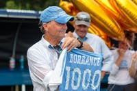Women's soccer head coach Anson Dorrance displays the soccer jersey made for him after Sunday's game, which marked his 1000th career victory.