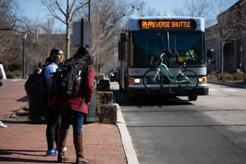 UNC-Chapel Hill Students await the RU, a bus route of Chapel Hill Transit. The Board of Aldermen seeks to improve public transportation by working with Chapel Hill Transit to more effectively manage the current level of public transportation services in Carrboro , and extend service into areas of Carrboro not served by a fixed route service. Damon Seils, Board of Aldermen's liaison to the Transportation Advisory Board, discussed how transportation may be used to fight climate change and give more people the opportunity to use public transportation.