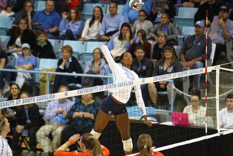 Outside Hitter, Taylor Leath (43), goes up for a hit against Clemson. The Tar Heels swept Clemson 3-0.