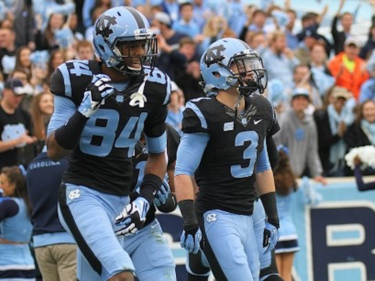 Former North Carolina wide receivers Bug Howard (84) and Ryan Switzer (3) celebrate after a touchdown against Old Dominion in 2013.
