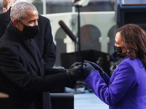 Former US President Barack Obama (L) bumps fists with US Vice President-elect Kamala Harris as they arrive for the inauguration of Joe Biden as the 46th US President, on the West Front of the US Capitol in Washington, DC on January 20, 2021. PHOTO BY JONATHAN ERNST/POOL/AFP via Getty Images)