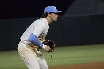 Junior Kyle Datres (3) stands at third base against Appalachian State on April 10 at Boshamer Stadium.