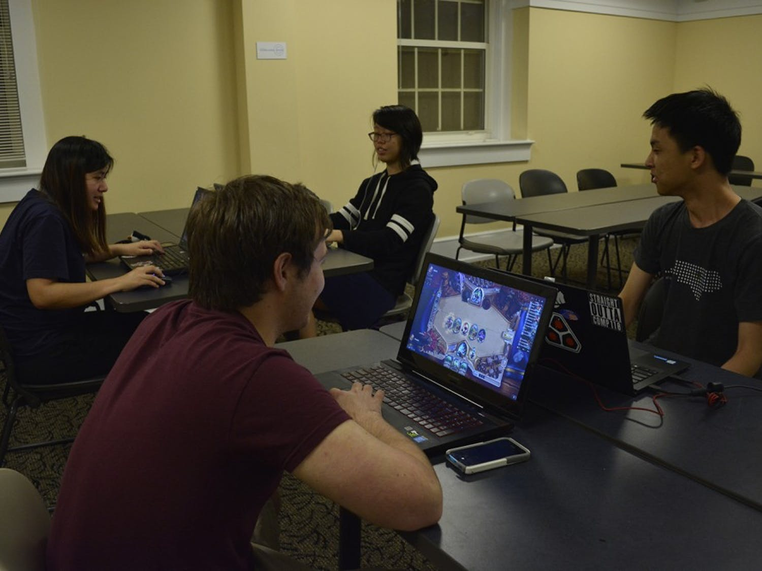 (From left) Joey Chau, Joe Plever (red shirt), Anne Chao (back right), and Cedric Nam play PC games at a UNC eSports meet up.