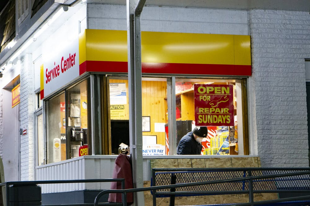 <p>An employee deemed an essential worker during the COVID-19 pandemic works at a gas station in Evanston, Illinois on Monday, Mar. 23, 2020.</p>