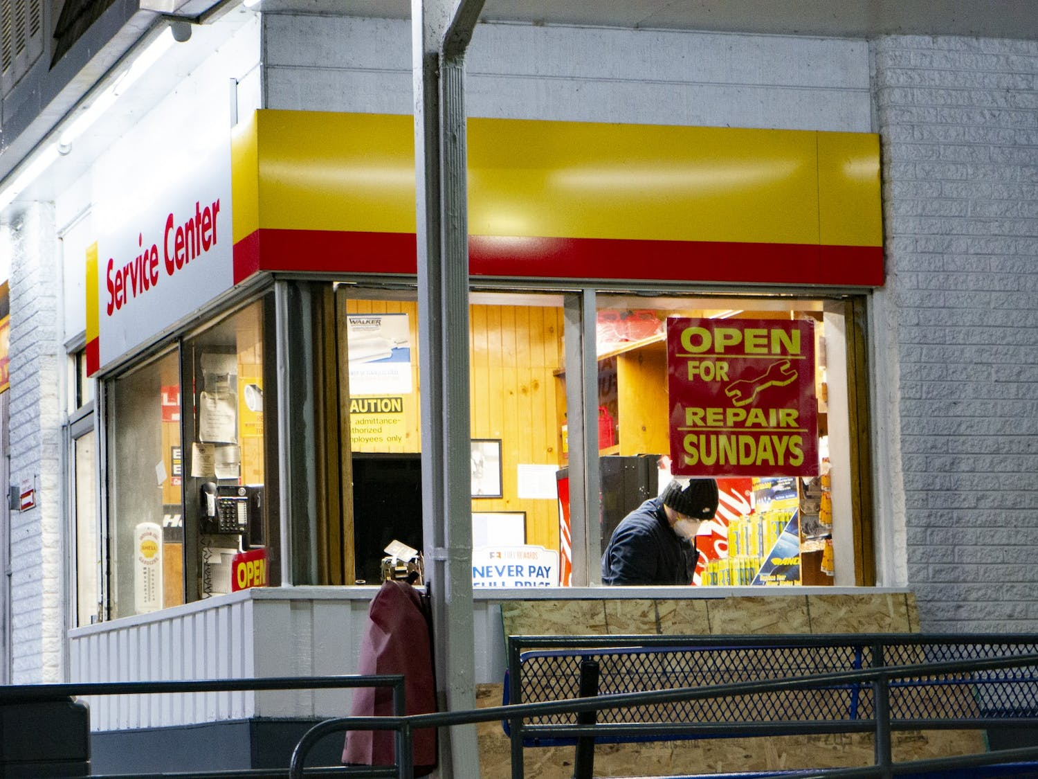 An employee deemed an essential worker during the COVID-19 pandemic works at a gas station in Evanston, Illinois on Monday, Mar. 23, 2020.
