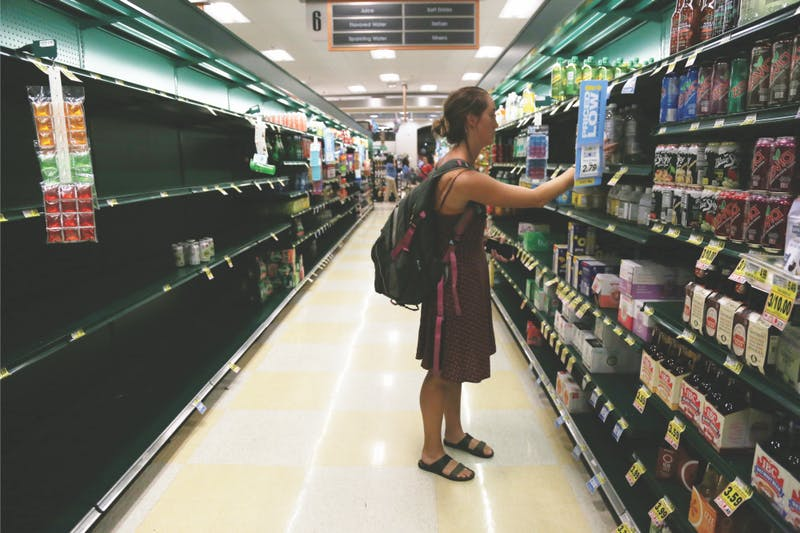 Junior global studies and geography double major Emily Adcock shops to get ready for Hurricane Florence on Tuesday, Sept. 11 at Harris Teeter.