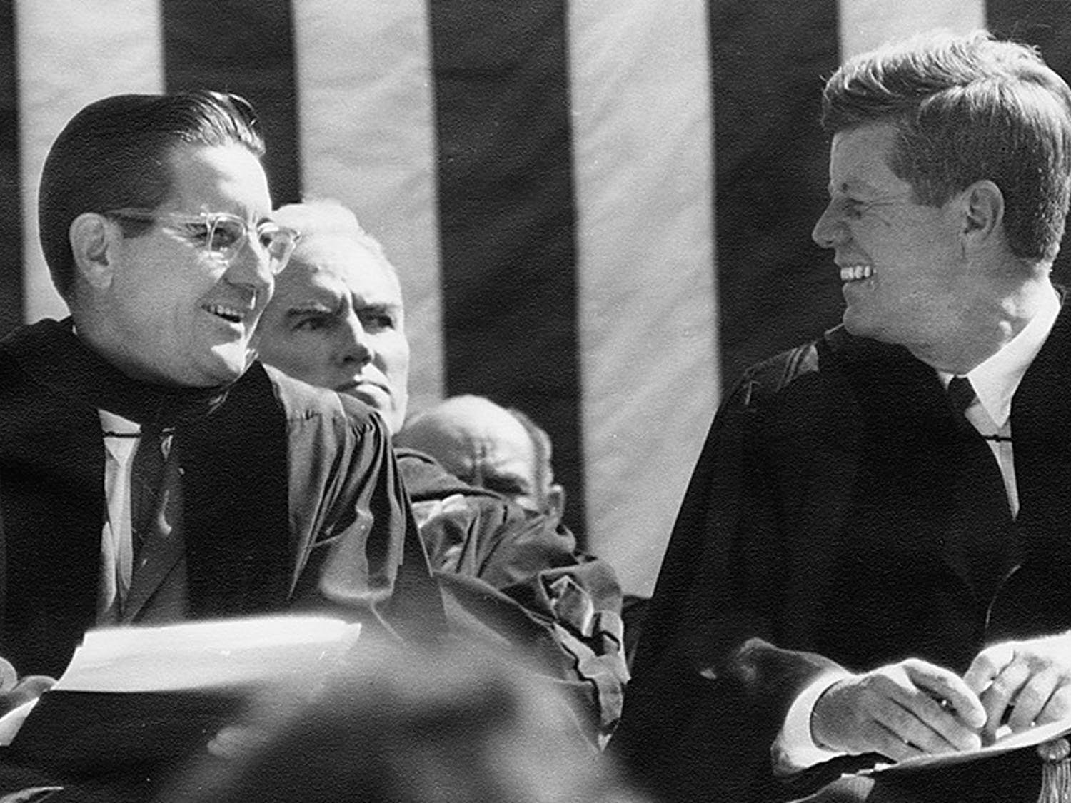 Bill Friday sits with President John F. Kennedy on stage at Kenan Stadium in 1961. President Kennedy came to UNC to speak on University Day. Courtesy of North Carolina Collection, UNC-CH
