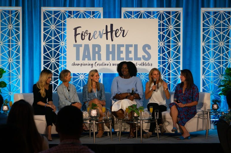 """Kristine Lilly (Soccer, '93) speaks among panel members at the Rams Club's """"FORevHER Tarheels"""" event on Saturday Oct. 5, 2019, an initiative created to raise up and empower UNC's female student athletes."""